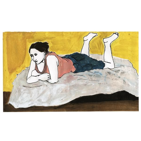 Una mujer tumbada en la cama