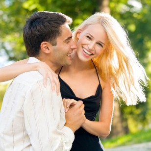 Young happy smiling attractive couple walking outdoors together