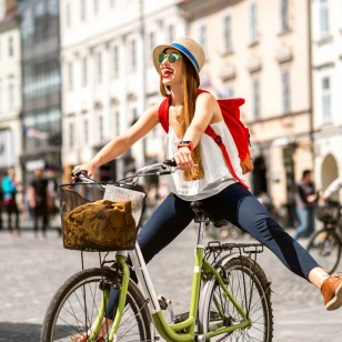 Woman riding a bicycle in the old european city
