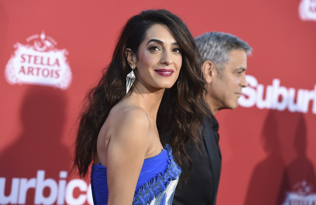 """Amal Clooney and George Hooney Hrive at the Los Angeles premiere of """"Suburbicon"""" on Sunday, Oct. 22, 2017 in Los Angeles. (Photo by Jordan Strauss/Invision/AP)"""