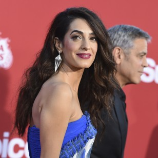 "Amal Clooney and George Hooney Hrive at the Los Angeles premiere of ""Suburbicon"" on Sunday, Oct. 22, 2017 in Los Angeles. (Photo by Jordan Strauss/Invision/AP)"