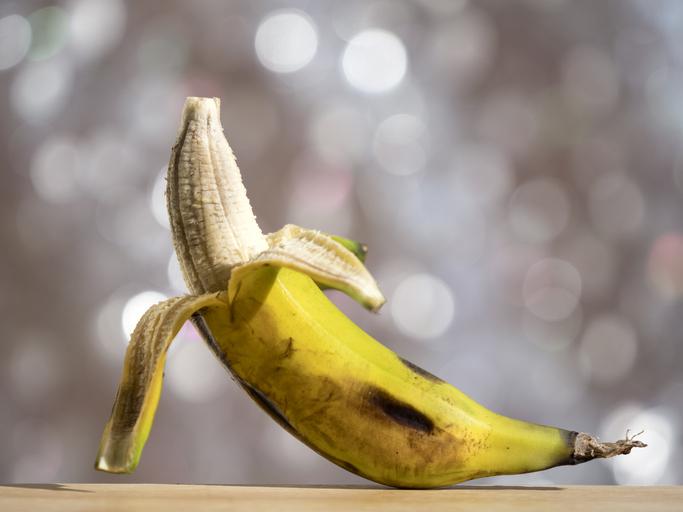 Close up of peeled banana, Illuminated by the light of the sun.