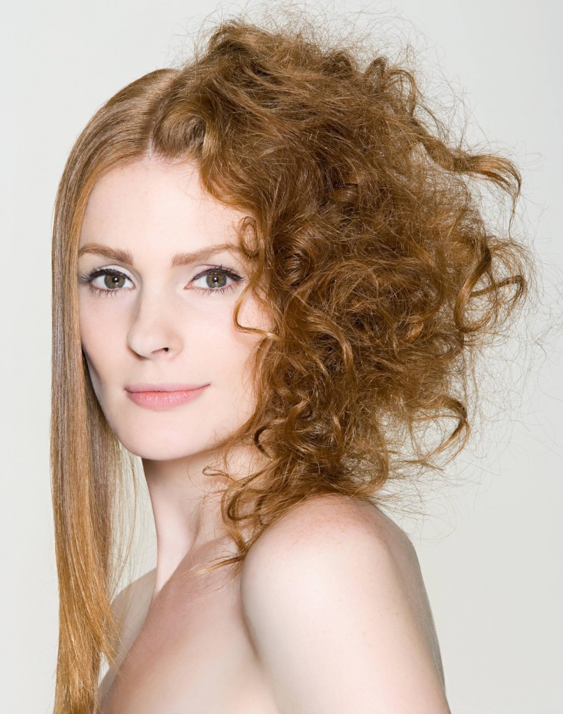 A woman with straight and curly hair
