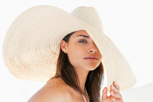 Portrait of woman wearing large sun hat