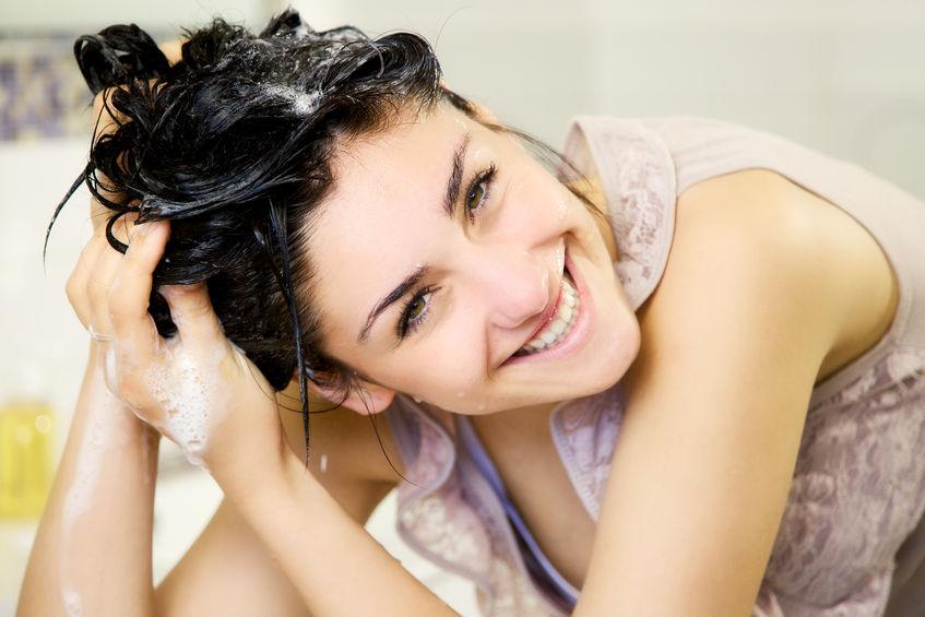 40657969 - cute girl in bathroom washing hair with shampoo