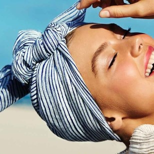1280x680_frau-turban-strand